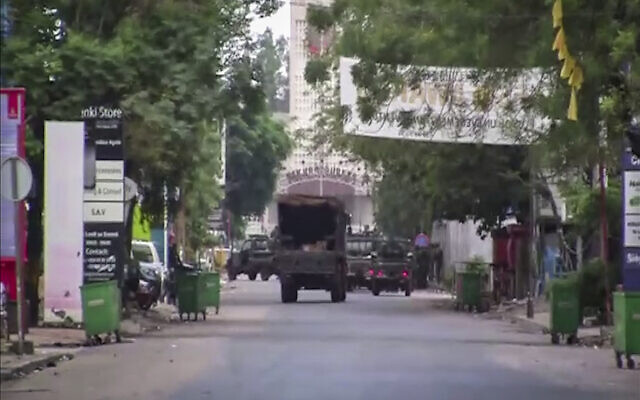 In this image from video, a military truck is seen near the presidential palace in the capital Conakry, Guinea, September 5, 2021. (AP)