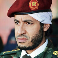 In this undated file photo made available on Sept. 25, 2011, al-Saadi Gaddafi, son of the late Libyan leader Moammar Gaddafi, watches a military exercise by the elite military unit commanded by his brother, Khamis, in Zlitan, Libya (AP Photo/Abdel Magid al-Fergany, File)