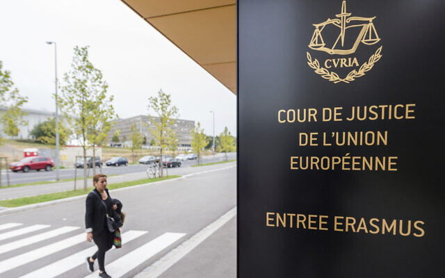 In this file photo taken October 5, 2015 a woman walks by the entrance to the European Court of Justice in Luxembourg (AP/Geert Vanden Wijngaert)