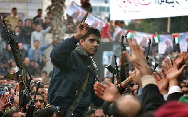 Zakaria Zubeidi, then-leader in the Al Aqsa Martyrs Brigade in the West Bank, is carried by supporters during a presidential elections campaign rally in support of Mahmoud Abbas, in the West Bank town of Jenin, on December 30, 2004. (Nasser Nasser/AP)
