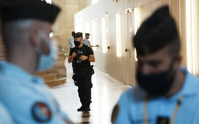 French police forces guard the special courtroom in Paris on September 8, 2021. (AP Photo/Thibault Camus)