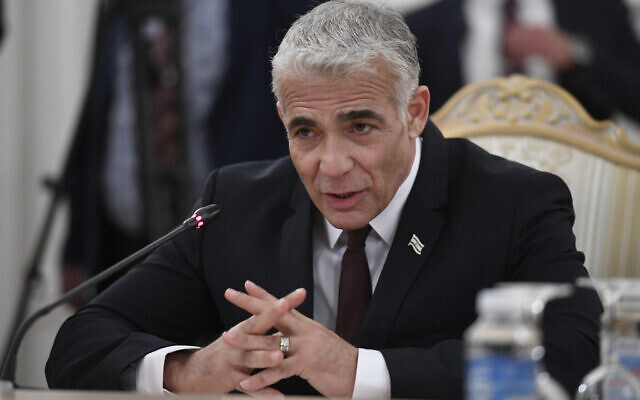 Israeli Foreign Minister Yair Lapid gestures as he speaks to Russian Foreign Minister Sergey Lavrov during their meeting in Moscow, Russia, Thursday, Sept. 9, 2021. (Alexander Nemenov/Pool Photo via AP)