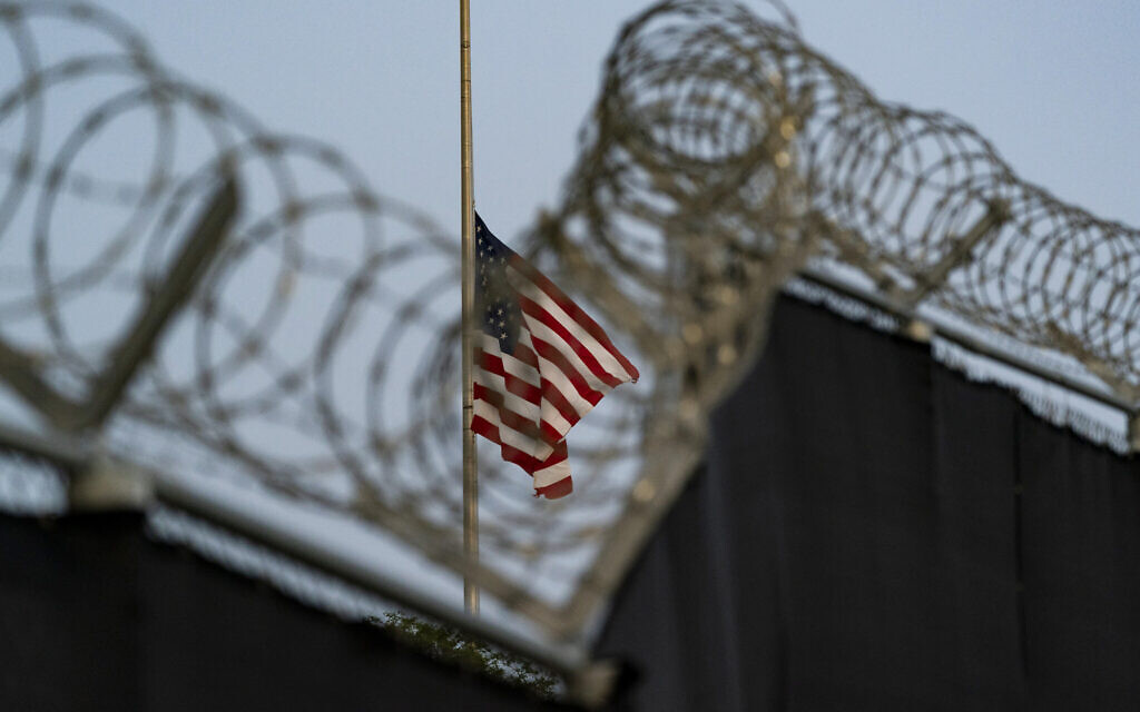 In this August 29, 2021, file photo reviewed by US military officials, a flag flies at half-staff in honor of the US service members and other victims killed in the terrorist attack in Kabul, Afghanistan, as seen from Camp Justice in Guantanamo Bay Naval Base, Cuba. (AP/Alex Brandon, File)