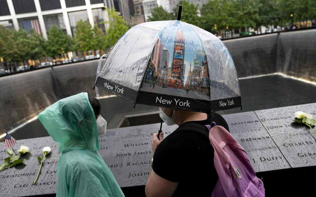 Visitors browse the south pool at the National September 11 Memorial & Museum, Sept. 9, 2021, in New York. (AP Photo/John Minchillo)