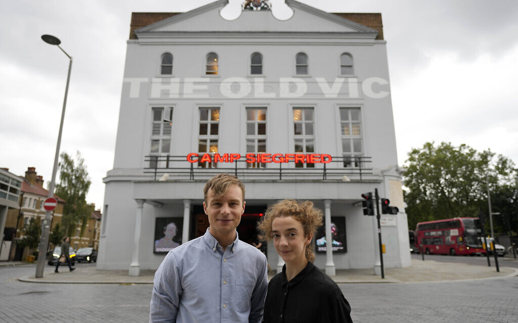 Actors Patsy Ferran, right and Luke Thallon, stars of the play Camp Siegfried, pose for a photographer in front of the Old Vic theatre in London, Friday, Sept. 10, 2021. (AP Photo/Frank Augstein)