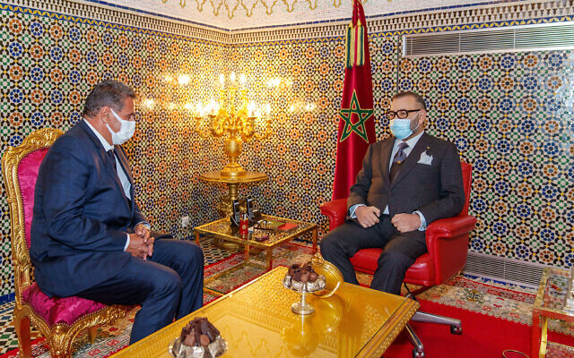 In this photo released by the Royal Palace, Morocco's King Mohammed VI, right, receives Aziz Akhannouch the president of the National Rally of Independents party (RNI), winner of the legislative elections at the Royal Palace in Fez, Morocco, September 10, 2021. (Moroccan Royal Palace via AP)