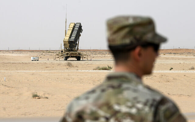 A member of the US Air Force stands near a Patriot missile battery at Prince Sultan Air Base in Saudi Arabia, February 20, 2020. (Andrew Caballero-Reynolds/Pool via AP, File)