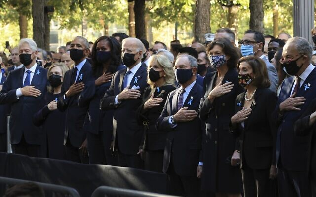 From left, former US President Bill Clinton, former First Lady Hillary Clinton, former President Barack Obama, Michelle Obama, President Joe Biden, first lady Jill Biden, former New York City Mayor Michael Bloomberg, Bloomberg's partner Diana Taylor, Speaker of the House Nancy Pelosi, D-Calif., and Senate Majority Leader Charles Schumer, D-NY, stand for the national anthem during the annual 9/11 Commemoration Ceremony at the National 9/11 Memorial and Museum, on Saturday, September 11, 2021 in New York. (Chip Somodevilla/Pool Photo via AP)