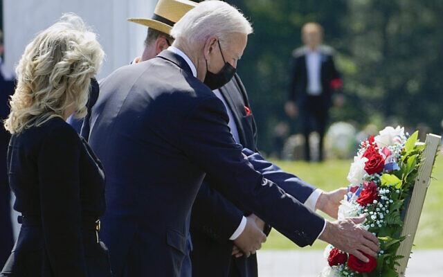 US President Joe Biden and first lady Jill Biden lay a wreath at the Wall of Names during a visit to the Flight 93 National Memorial in Shanksville, PA, on September 11, 2021. (AP Photo/Evan Vucci)
