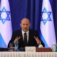 Prime Minister Naftali Bennett attends a cabinet meeting at the Foreign Ministry office in Jerusalem on Sunday, Sept. 12, 2021. (Abir Sultan/Pool Photo via AP)