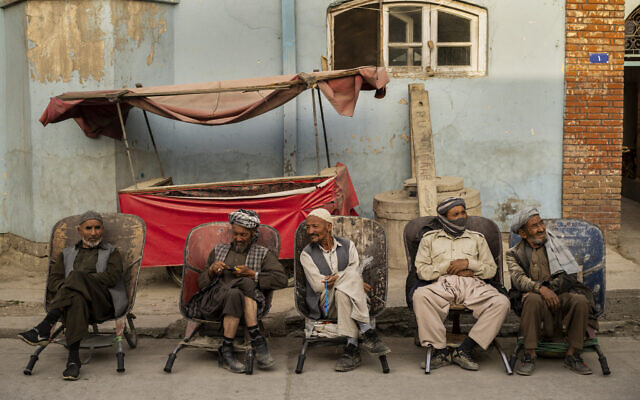 Laborers wait in the street to be hired, in Kabul, Afghanistan, September 12, 2021. (Bernat Armangue/AP)