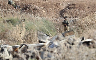 Israeli soldiers take positions along the border between the northern West Bank near Jenin and Israel as they search for two Palestinians who broke out of a maximum-security prison last week, on a road leading to the West Bank town of Jenin, near Gan Ner Israel, September 12, 2021. (AP/Ariel Schalit)