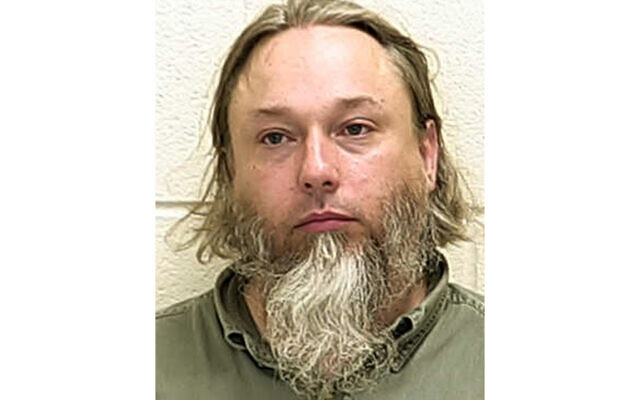 This undated file photo provided by The Ford County Sheriff's Office in Paxton, Ill., shows Michael Hari, a militia leader convicted of masterminding the bombing of a Minnesota mosque. (Ford County Sheriff's Office via AP File)