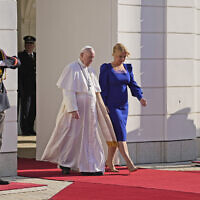 Pope Francis, flanked by Slovakian President Zuzana Caputova, right, attends a welcoming ceremony at the presidential palace in Bratislava, Slovakia, Monday, Sept. 13, 2021. (AP Photo/Gregorio Borgia)