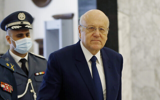 Lebanese Prime Minister Najib Mikati arrives to attend a cabinet meeting at the presidential palace in Baabda, east of Beirut, Lebanon, Monday, Sept. 13, 2021. (AP Photo/Bilal Hussein)