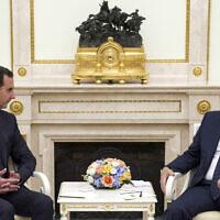 Russian President Vladimir Putin, right, listens to Syrian President Bashar Assad during their meeting in the Kremlin in Moscow, Russia, September 13, 2021. (Mikhail Klimentyev, Sputnik, Kremlin Pool Photo via AP)