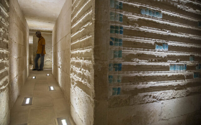 A worker stands inside the southern cemetery of King Djoser, after its restoration, near the famed Step Pyramid, in Saqqara, south of Cairo, Egypt, September 14, 2021. (AP Photo/Nariman El-Mofty)