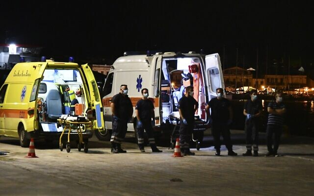 Paramedics wait next to ambulances at Pythagorio port, on the eastern Aegean island of Samos, Greece, late Monday, Sept. 13, 2021, after the crash of a private plane from Israel that killed a prosecution witness in the corruption trial of former prime minister Benjamin Netanyahu. (AP Photo/Michael Svarnias)