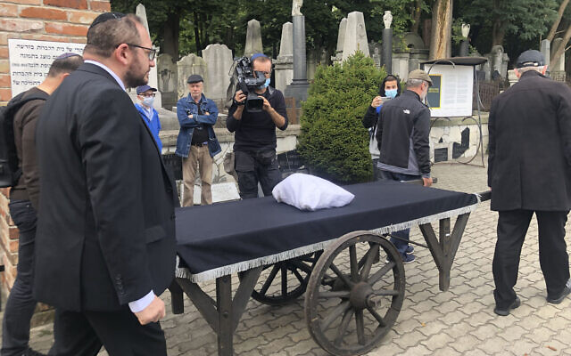 Warsaw's Jewish community held a funeral for an unidentified Holocaust victim, after human remains were recently discovered in an area that belonged to the Warsaw Ghetto during World War II, in Warsaw, Poland, on September 14, 2021. (AP Photo/Vanessa Gera)
