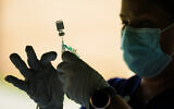 A syringe is prepared with the Pfizer COVID-19 vaccine at a clinic at the Reading Area Community College in Reading, Pennsylvania, September 14, 2021. (AP/Matt Rourke)
