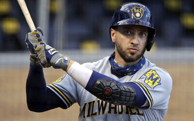 In this July 28, 2020, file photo, Milwaukee Brewers' Ryan Braun warms up on deck during the first inning of a baseball game against the Pittsburgh Pirates in Pittsburgh. (AP Photo/Gene J. Puskar, File)