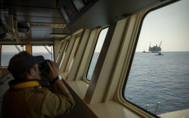 An Israeli Navy sailor looks at Israel's offshore Leviathan gas field from on board the Israeli Navy Ship Atzmaut as a submarine patrols in the Mediterranean Sea, September 1, 2021. (AP Photo/Ariel Schalit)