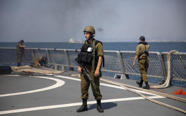 Israeli Navy sailors man the deck of the Israeli Navy Ship Atzmaut, in the Mediterranean Sea , September 1, 2021. (AP Photo/Ariel Schalit)