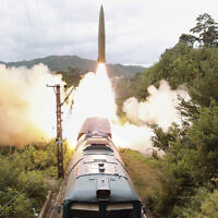 This photo provided by the North Korean government, on September 16, 2021, shows a missile test firing launched from a train on September 15, 2021 in an undisclosed location of North Korea (Korean Central News Agency/Korea News Service via AP)