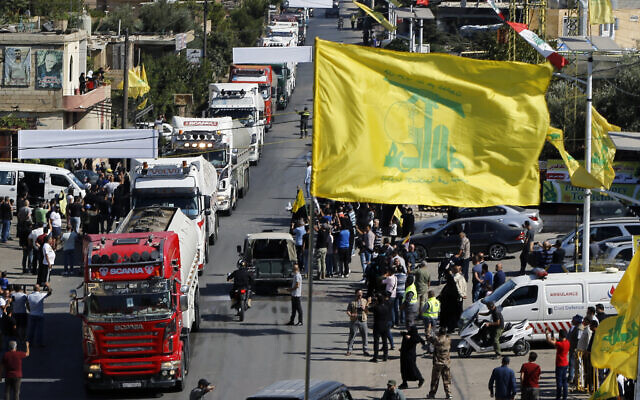 A convoy of tanker trucks carrying Iranian diesel across the border from Syria into Lebanon arrives at the eastern town of al-Ain, Lebanon, on September 16, 2021. (AP Photo/Bilal Hussein)