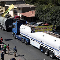 A convoy of tanker trucks carrying Iranian diesel across the border from Syria into Lebanon arrives at the eastern town of al-Ain, Lebanon, on September 16, 2021. (AP/ Bilal Hussein)