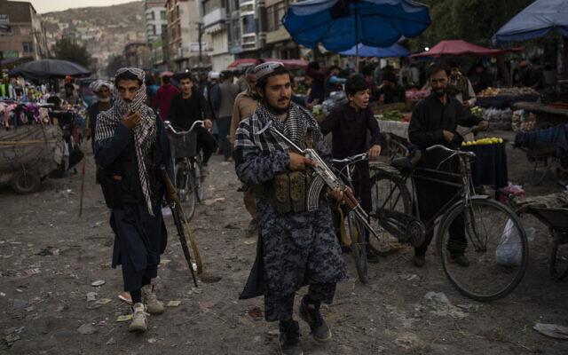 Taliban fighters patrol a market in Kabul's Old City, Afghanistan, on September 14, 2021. (AP Photo/Bernat Armangue)