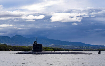 In this photo provided by US Navy, the Virginia-class fast-attack submarine USS Missouri (SSN 780) departs Joint Base Pearl Harbor-Hickam for a scheduled deployment in the 7th Fleet area of responsibility, on September 1, 2021. (Chief Mass Communication Specialist Amanda R. Gray/US Navy via AP)