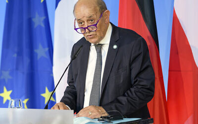 In this Friday, Sept. 10, 2021 file photo, French Foreign Minister Jean-Yves Le Drian speaks in Weimar, Germany. France said late Friday, Sept. 17 it was immediately recalling its ambassadors to the US and Australia after Australia scrapped a big French conventional submarine purchase in favor of nuclear subs built with U.S. technology. (Jens Schlueter/Pool Photo via AP, file)