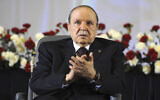 In this April 28, 2014, file photo, Algerian President Abdelaziz Bouteflika, sitting in a wheelchair, applauds after taking the oath as President in Algiers. Former Algerian President Bouteflika, who fought for independence from France in the 1950s and 1960s and was ousted amid pro-democracy protests in 2019 after 20 years in power, has died at age 84, state television announced Friday, Sept. 17, 2021. (AP Photo/Sidali Djarboub, File)