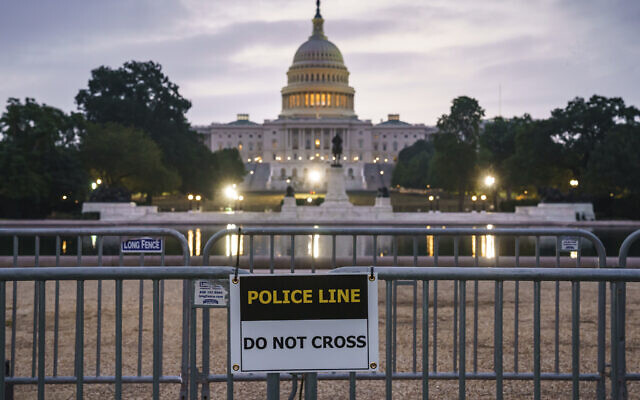 """Security measures are put into place before a rally by allies of Donald Trump in support of the so-called """"political prisoners"""" of the January 6 insurrection at the US Capitol, on Capitol Hill in Washington, Saturday, Sept. 18, 2021. (AP/J. Scott Applewhite)"""