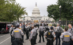 Police stage at a security fence ahead of a rally near the US Capitol in Washington, DC, on September 18, 2021. (AP Photo/Nathan Howard)