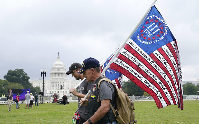 """People arrive to attend a rally near the US Capitol in Washington, Saturday, Sept. 18, 2021. The rally was planned by allies of former President Donald Trump and aimed at supporting the so-called """"political prisoners"""" of the Jan. 6 insurrection at the US Capitol. (AP/Alex Brandon)"""
