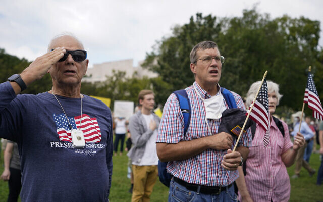 People stand as the national anthem plays during a rally near the US Capitol in Washington, Saturday, Sept. 18, 2021.  (AP/Brynn Anderson)
