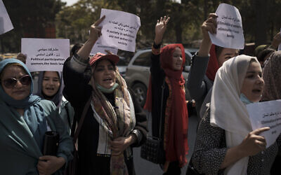 Women march to demand their rights under the Taliban rule during a demonstration near the former Women's Affairs Ministry building in Kabul, Afghanistan, September 19, 2021. (AP Photo)