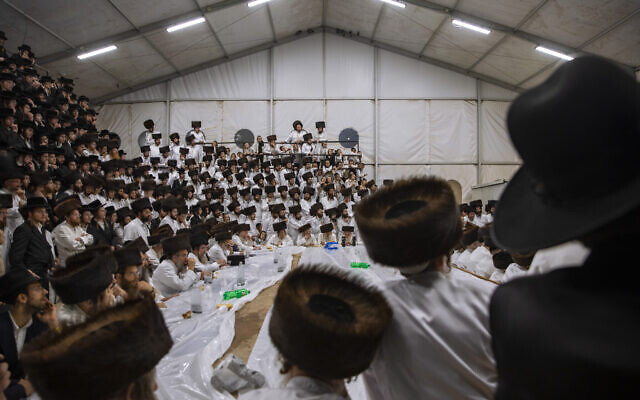 """Ultra-Orthodox Jews, members of the Lelov Hassidic dynasty attend the """"Pidyon Haben"""" ceremony for the great grandchild of their chief rabbi Aharon Biderman in Beit Shemesh, Israel, on September 16, 2021. (AP/Oded Balilty)"""