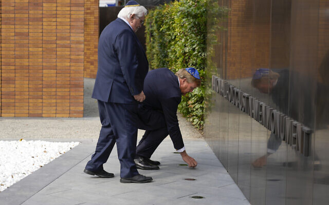 King Willem-Alexander puts a stone in an act of remembrance when unveiling a new monument in the heart of Amsterdam's historic Jewish Quarter on September 19, 2021, honoring the 102,000 Dutch victims of the Holocaust. (AP Photo/Peter Dejong)