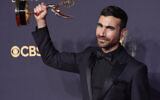 """Brett Goldstein, winner of the award for outstanding supporting actor in a comedy series for """"Ted Lasso,"""" poses for a photo at the 73rd Primetime Emmy Awards on Sunday, Sept. 19, 2021, at L.A. Live in Los Angeles. (AP Photo/Chris Pizzello)"""