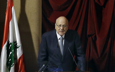 Lebanese Prime Minister Najib Mikati speaks during a parliament session to confirm Lebanon's new government at a Beirut theater known as the UNESCO palace, so that parliament members could observe social distancing measures imposed over the coronavirus pandemic, on September 20, 2021. (AP/Bilal Hussein)