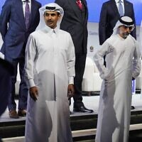 Qatar's Minister of State for Energy Affairs Saad Sherida al-Kaabi, center left, awaits a posed photo op with Emirati Energy and Infrastructure Minister Suhail al-Mazrouei, center right, during the Gastech 2021 conference in Dubai, United Arab Emirates, September 21, 2021. (AP Photo/Jon Gambrell)