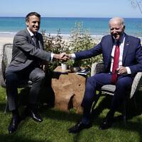 US President Joe Biden and French President Emmanuel Macron shake hands during a bilateral meeting at the G-7 summit, in Carbis Bay, England, June 12, 2021. (Patrick Semansky/AP)