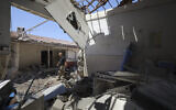 A man walks through a heavily damaged hospital in the city of Afrin, Syria, on June 13, 2021. (AP Photo/Ghaith Alsayed, File)