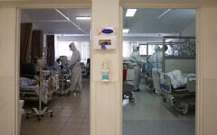 In this August 26, 2021 file photo, medical professionals treat patients in the coronavirus ward at Barzilai Medical Center in Ashkelon, Israel. (AP Photo/Maya Alleruzzo, File)
