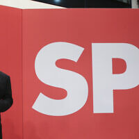 Olaf Scholz, Finance Minister and SPD candidate for Chancellor, waves during the election party at Willy Brandt House in Berlin, September 26, 2021. (Wolfgang Kumm/dpa via AP)