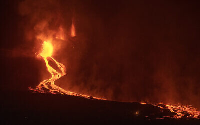 Lava flows from a volcano on the Canary island of La Palma, Spain in the early hours of September 28, 2021. (AP Photo/Saul Santos)
