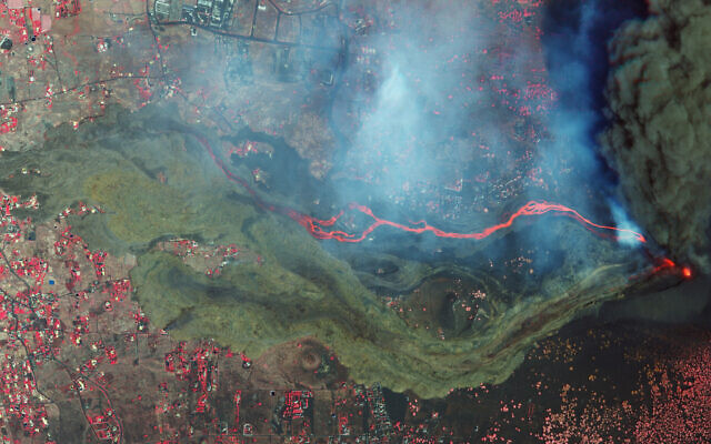 In this September 26, 2021 satellite photo from Planet Labs Inc. lava and ash from a volcano on the Canary island of La Palma, Spain can be seen. (Planet Labs Inc. via AP)